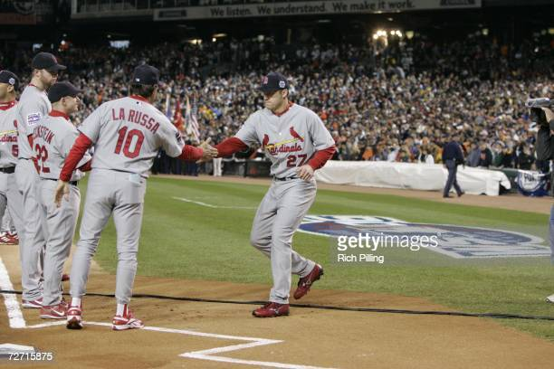 Manager Tony La Russa of the St. Louis Cardinals shakes hands with Scott Rolen prior to Game One of the 2006 World Series on October 21, 2006 at...
