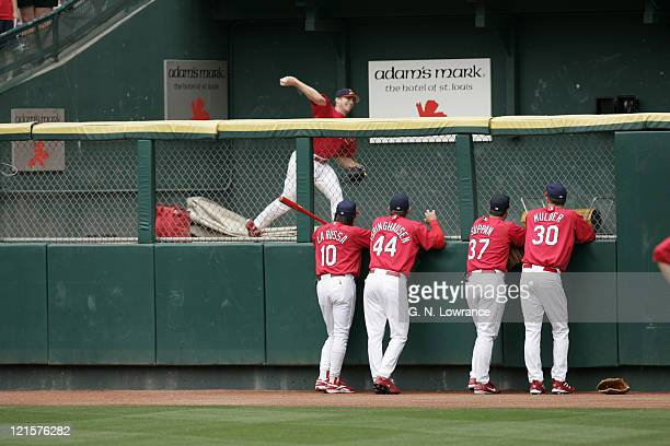Manager Tony LaRussa and other members of the St Louis Cardinals watch starting pitcher Chris Carpenter warm up prior to a game against the...