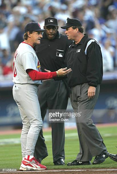 Manager Tony LaRussa of the St Louis Cardinals argues with umpires Chuck Meriweather and Gerry Davis after a bunt by Jose Lima of the Los Angeles...