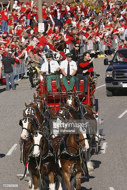Manager Tony LaRussa of the St. Louis Cardinals rides on the Budweiser cart during the World Series championship victory parade on October 29, 2006...