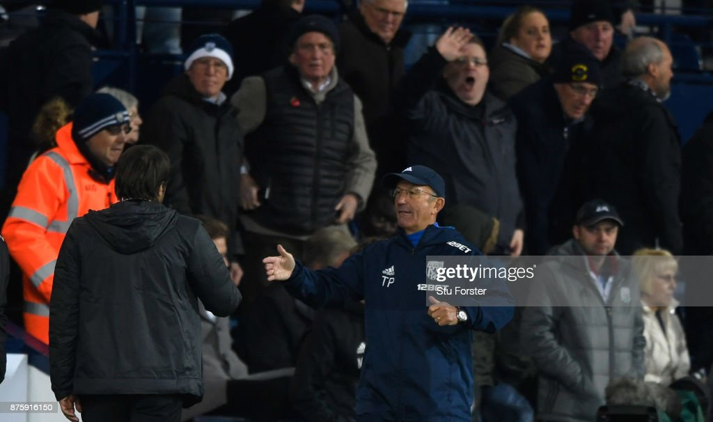 WBA manager Tony Pulis congratulates Antonio Conte (l) as the fans react after the Premier League match between West Bromwich Albion and Chelsea at The Hawthorns on November 18, 2017 in West Bromwich, England.