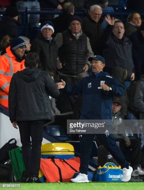 WBA manager Tony Pulis congratulates Antonio Conte as the fans react after the Premier League match between West Bromwich Albion and Chelsea at The...
