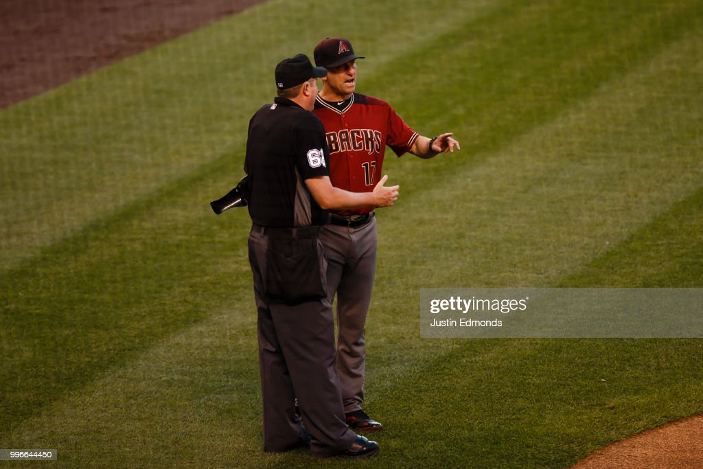 Manager Torey Lovullo #17 of the Arizona Diamondbacks argues a balk call that allowed a run to score with umpire Chad Whitson #62 in the second inning against the Colorado Rockies at Coors Field on July 11, 2018 in Denver, Colorado.