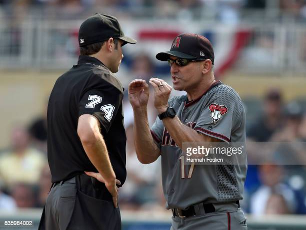 Manager Torey Lovullo of the Arizona Diamondbacks argues with home plate umpire John Tumpane after being ejected from the game against the Minnesota...