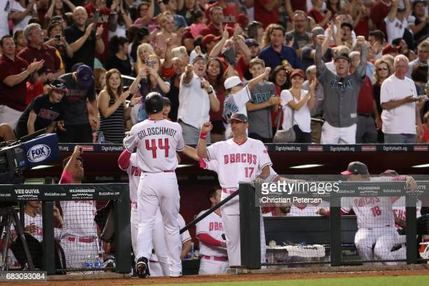 Manager Torey Lovullo of the Arizona Diamondbacks high fives Paul Goldschmidt after Goldschmidt hit a solo home run against the Pittsburgh Pirates...