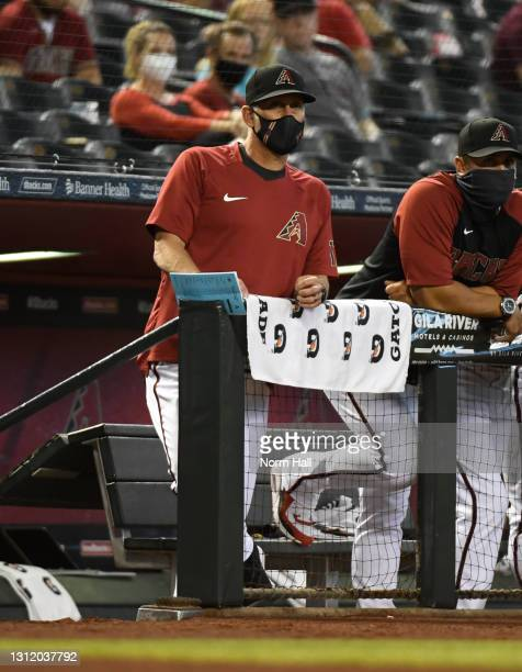 Manager Torey Lovullo of the Arizona Diamondbacks looks on from the dugout against the Cincinnati Reds at Chase Field on April 10, 2021 in Phoenix,...