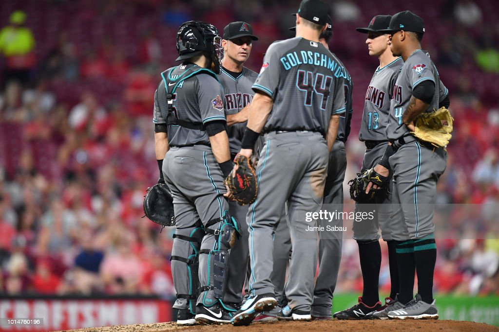 Manager Torey Lovullo #17 of the Arizona Diamondbacks visits the mound in the seventh inning against the Cincinnati Reds at Great American Ball Park on August 10, 2018 in Cincinnati, Ohio. Cincinnati defeated Arizona 3-0.