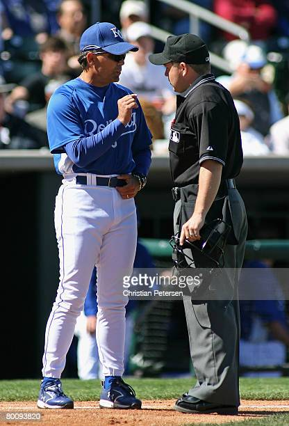 Manager Trey Hillman of the Kansas City Royals argues a call with home plate umpire RJ Thompson during the spring training game against the Chicago...