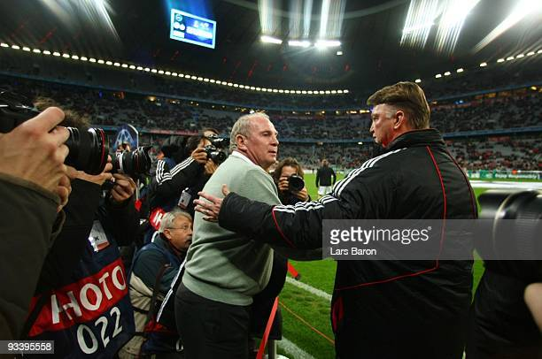 Manager Uli Hoeness and head coach Louis van Gaal of Bayern shake hands in the focus of media during the UEFA Champions League Group A match between...