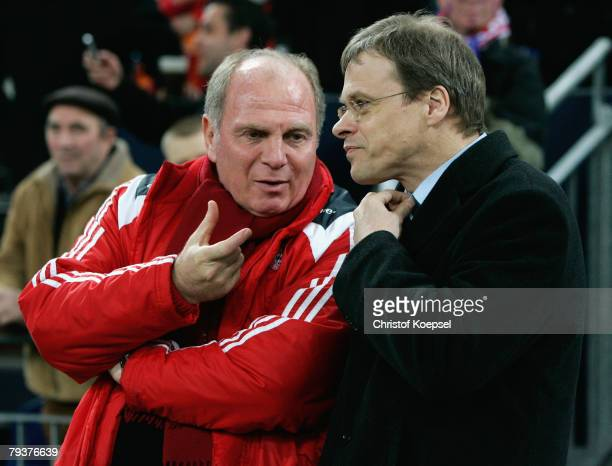 Manager Uli Hoeness of Bayern talks to managing director Peter Peters of Schalke before the DFB Cup round of 16 match between Wuppertaler SV and...