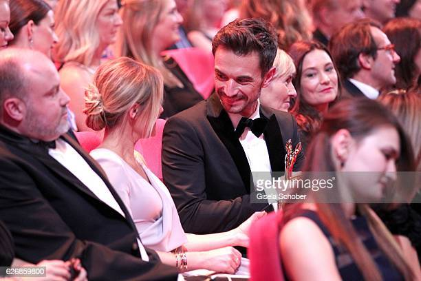 Manager Uwe Kanthak Florian Silbereisen and his girlfriend Helene Fischer in the audience during the Bambi Awards 2016 show at Stage Theater on...