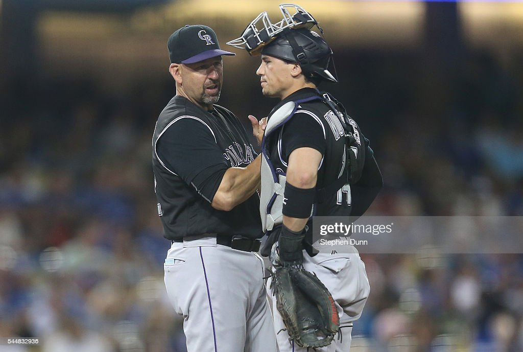 Manager Walt Weiss and catcher Tony Wolters #14 of the Colorado Rockies talk on the mound as Weiss makes a pitching change in the seventh inning against the Los Angeles Dodgers at Dodger Stadium on July 2, 2016 in Los Angeles, California.