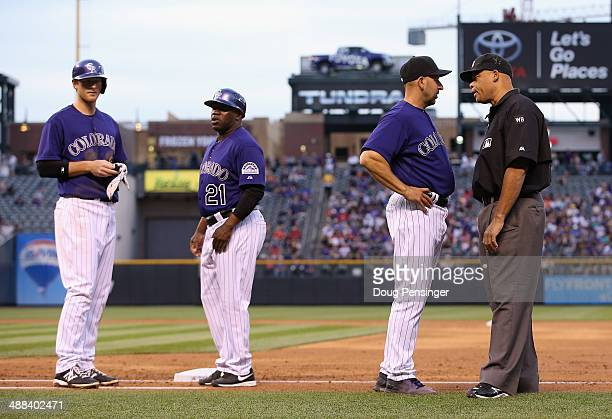 Manager Walt Weiss of the Colorado Rockies challenges a call by umpire Kerwin Danley on a play at first base against the Texas Rangers as DJ LeMahieu...