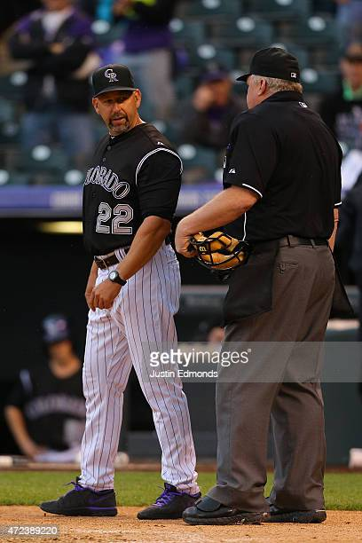 Manager Walt Weiss of the Colorado Rockies has a word with home plate umpire Bill Miller after getting ejected from the game in the third inning...