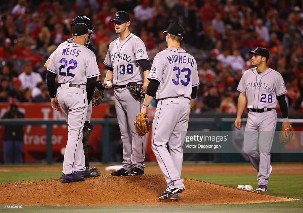 Manager Walt Weiss #22 of the Colorado Rockies visits the mound to talk to Kyle Kendrick #38 in the seventh inning during the MLB game against the Los Angeles Angels of Anaheim at Angel Stadium of Anaheim on May 12, 2015 in Anaheim, California. The Angels defeated the Rockies 5-2.