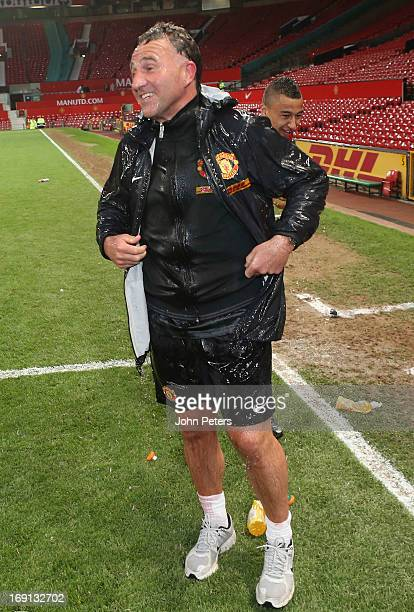 Manager Warren Joyce of Manchester United U21s is drenched while being interviewed by MUTV after the Barclays U21s Elite Group Final between...