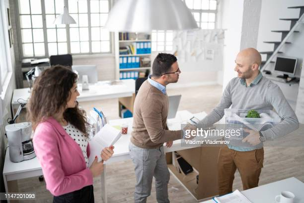 manager welcoming a new coworker at workplace - new stock pictures, royalty-free photos & images