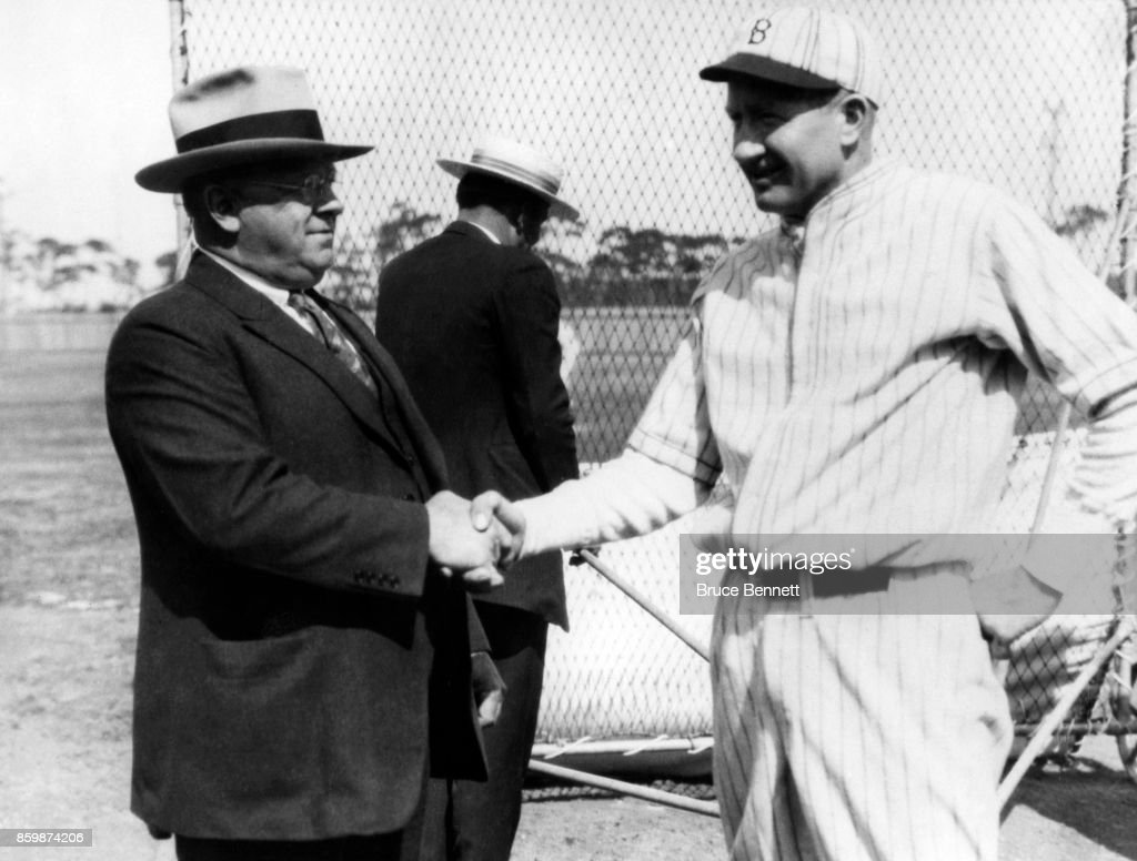 Manager Wilbert Robinson of the Brooklyn Robins shakes hands with pitcher Dazzy Vance circa 1920's.