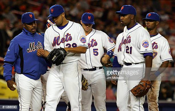 Manager Willie Randolph of the New York Mets removes Claudio Vargas from the game in the seventh inning against the Washington Nationals as his...