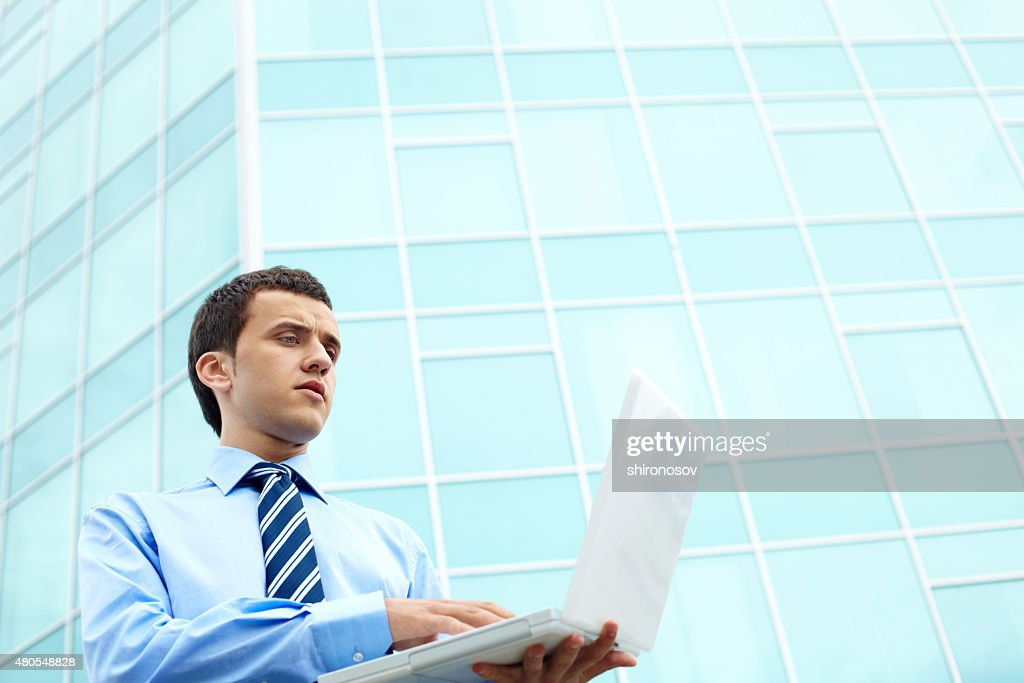 Manager with computer : Stock Photo