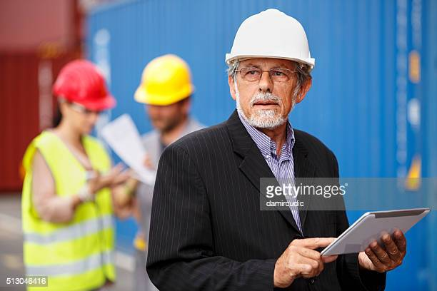 Manager with digital tablet at commercial dock