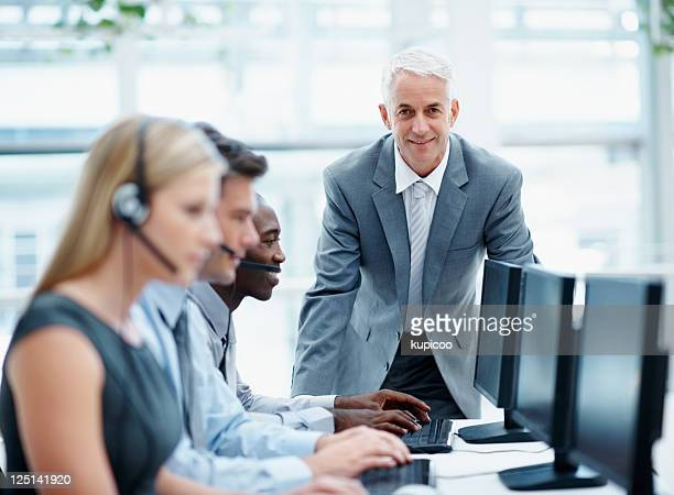 Manager with young business staff working in a call center