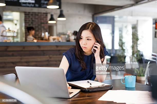 manager working at cafe - one mid adult woman only stock pictures, royalty-free photos & images