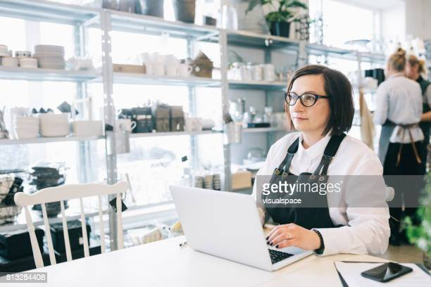Manager working in a Small Design Shop