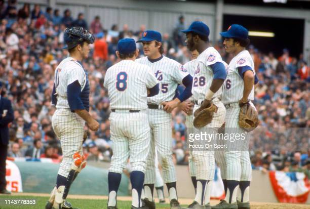 Manager Yogi Berra of the New York Mets comes out to the mound to talk with pitcher Tug McGraw during a Major League Baseball game circa 1973 at Shea...