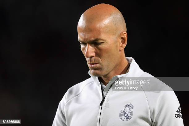 Manager Zinedine Zidane of Real Madrid looks on after a match against Manchester City during the International Champions Cup soccer match at Los...