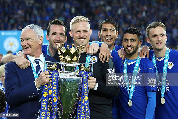 Manager/Head Coach of Leicester City Claudio Ranieri Kasper Schmeichel Christian Fuchs Leonardo Ulloa Riyad Mahrez and Andy King hold the Premier...