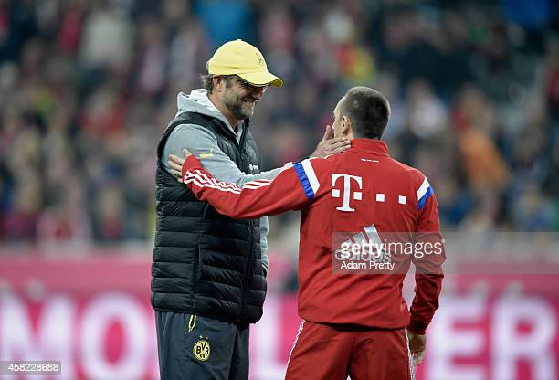 ManagerJurgen Klopp of Borussia Dortmund speaks to Franck Ribery of Bayern Muenchen during the Bundesliga match between FC Bayern Muenchen and...