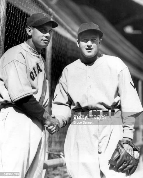 Manager/player Bill Terry of the New York Giants and manager/player Joe Cronin of the Washington Senators shake hands as they pose for a portrait...