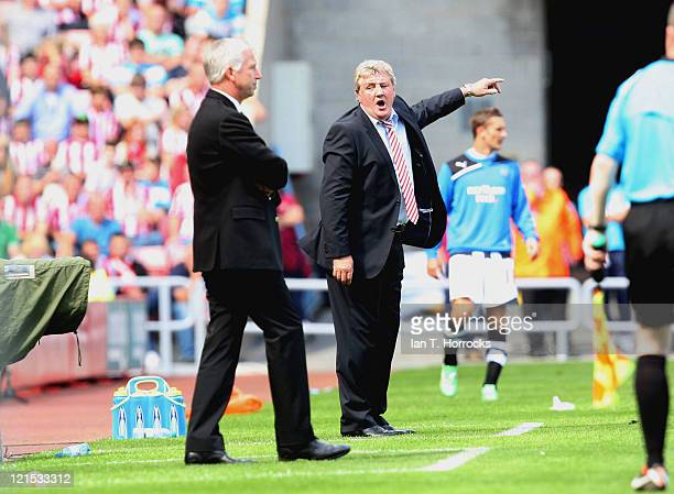 Managers Alan Pardew and Steve Bruce during the Barclays Premier League match between Sunderland and Newcastle United at the Stadium of Light on...