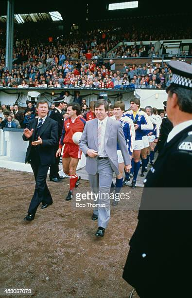 Managers Alex Ferguson of Aberdeen FC and John Greig of Rangers FC lead their teams out before the start of the Scottish Cup final at Hampden Park...