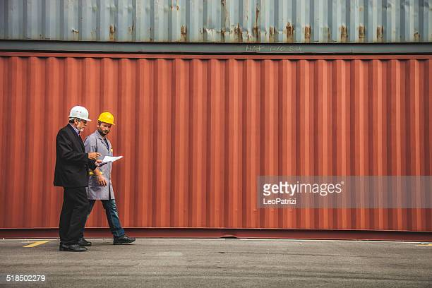 Managers and worker at commercial dock