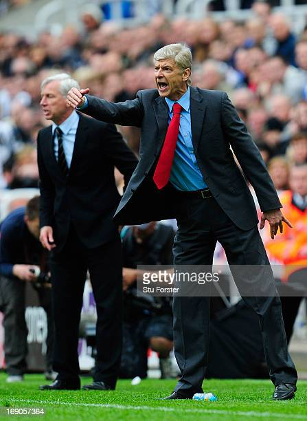 Managers Arsene Wenger of Arsenal and Alan Pardew of Newcastle react during the Barclays Premier League match between Newcastle United and Arsenal at...