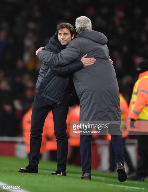 Managers Arsene Wenger of Arsenal and Antonio Conte hug after the Premier League match between Arsenal and Chelsea at Emirates Stadium on January 3...