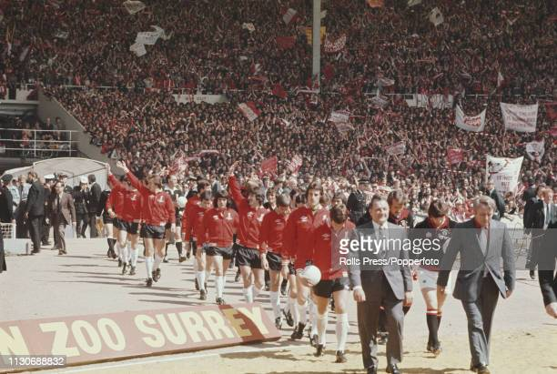 Managers Bob Paisley of Liverpool and Tommy Docherty of Manchester United lead their respective teams out on to the pitch prior to play between...