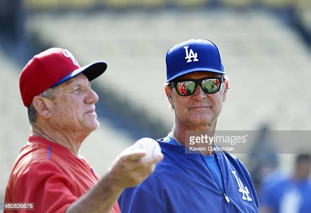 Managers Don Mattingly of the Los Angeles Dodgers and Larry Bowa of the Philadelphia Phillies before the start of MLB baseball game against the...