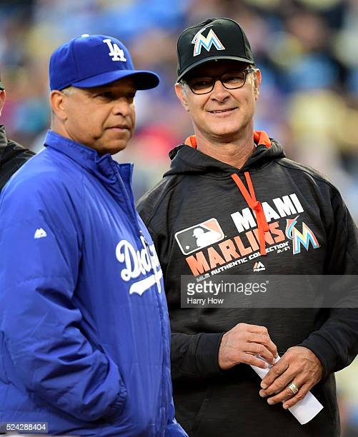 Managers Don Mattingly of the Miami Marlins and Dave Roberts of the Los Angeles Dodgers talk before the start of the game at Dodger Stadium on April...