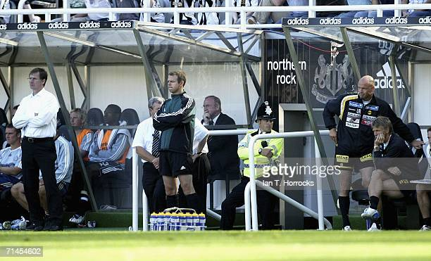 Managers Glenn Roeder and Uwe Rosler of Newcastle watch from the dugout during the UEFA Intertoto Cup third round First leg match between Newcastle...