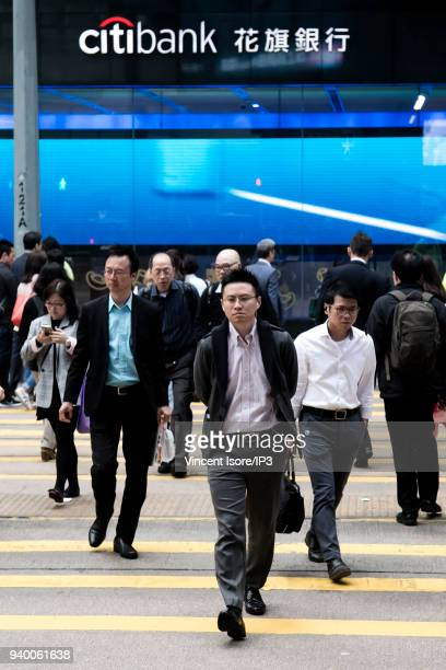 Managers go to work in the Central area in the financial center on February 27 2018 in HongKong China HongKong is the third largest financial centre...
