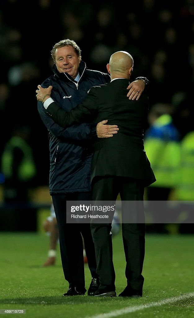 Managers Harry Redknapp of QPR and Giuseppe Sannino of Watford embrace at the final whistle during the Sky Bet Championship match between Watford and Queens Park Rangers at Vicarage Road on December 29, 2013 in Watford, England,