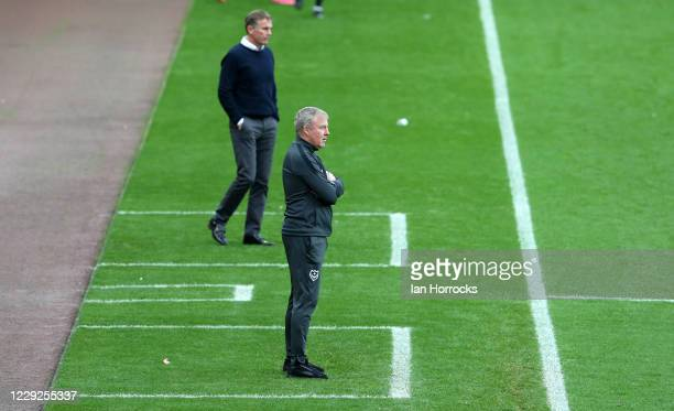 Managers Kenny Jacket of Portsmouth and Phil Parkinson of Sunderland watch the game during the Sky Bet League One match between Sunderland and...