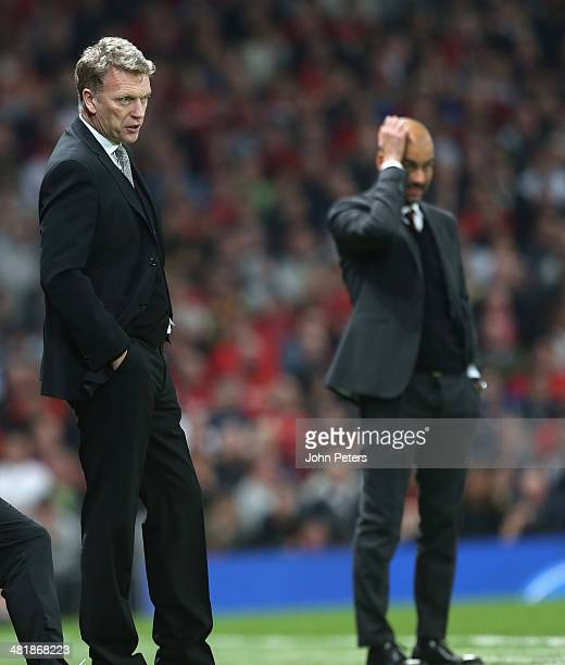 Managers Manager David Moyes of Manchester United and Josep Guardiola of Bayern Munich watch from the touchline during the UEFA Champions League...