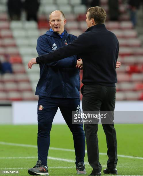Managers Phil Parkinson of Bolton and Simon Grayson shake hands on the final whistle during the Sky Bet Championship match between Sunderland and...