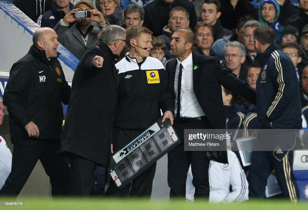Managers Sir Alex Ferguson of Manchester United and Roberto di Matteo of Chelsea argue on the touchline during the Barclays Premier League match between Chelsea and Manchester United at Stamford Bridge on October 28, 2012 in London, England.