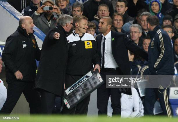 Managers Sir Alex Ferguson of Manchester United and Roberto di Matteo of Chelsea argue on the touchline during the Barclays Premier League match...