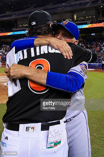 Managers Terry Collins of the New York Mets and Don Mattingly of the Miami Marlins hug after the game at Marlins Park on September 28 2016 in Miami...